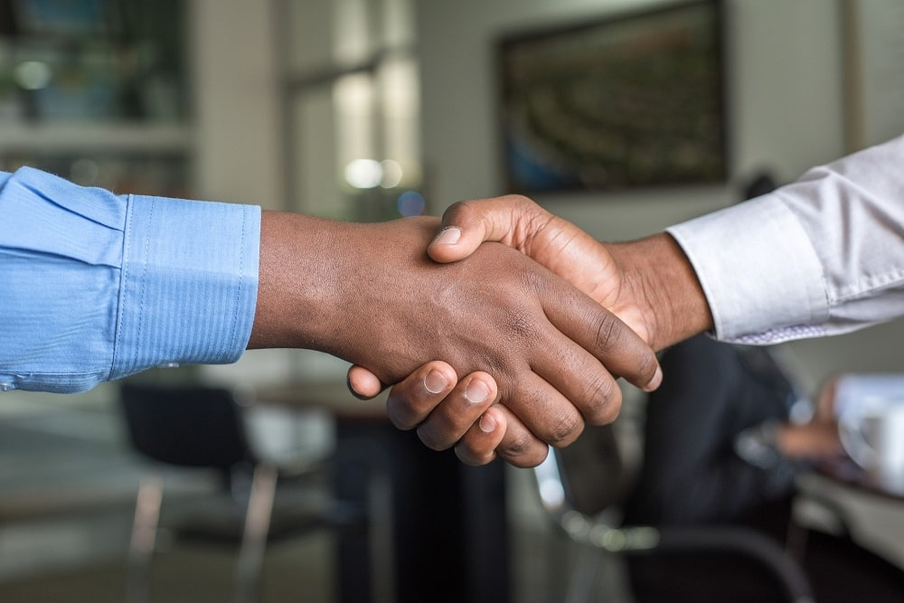 Two men shaking hands and making a connection.