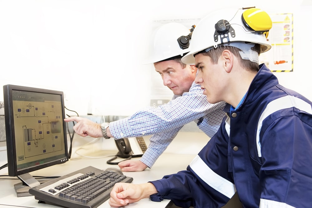 A senior engineer training an engineering graduate for a post-college internship position.