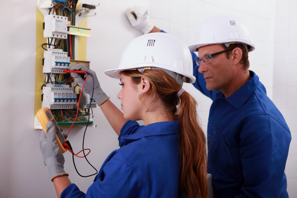 A female engineering graduate getting exposure and hands-on experience during her post-college internship with the help of a senior engineer.