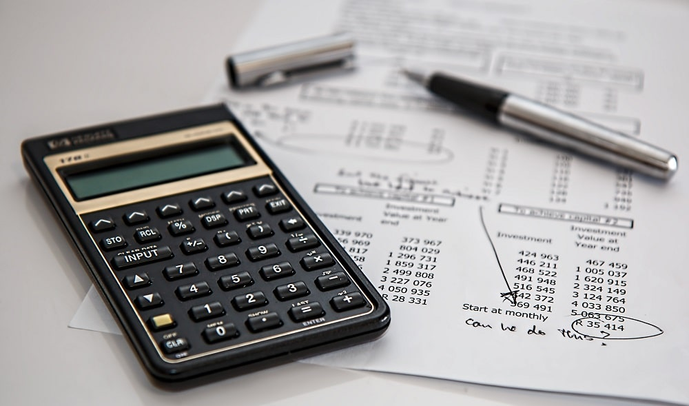 An accountant crunching the number and calculating finances.