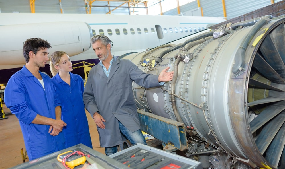 Engineers looking at an aircraft engine.