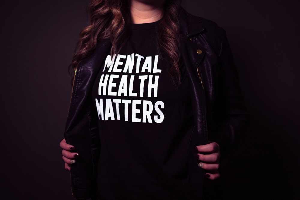 A woman wearing a shirt that says mental health matters.