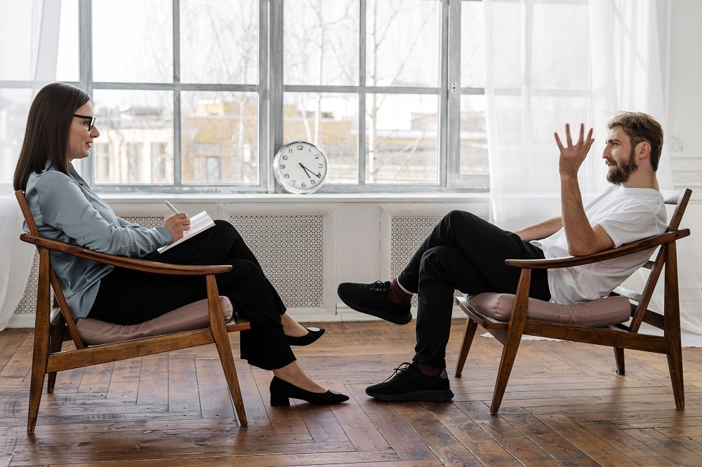 A psychotherapist in a session with a patient.