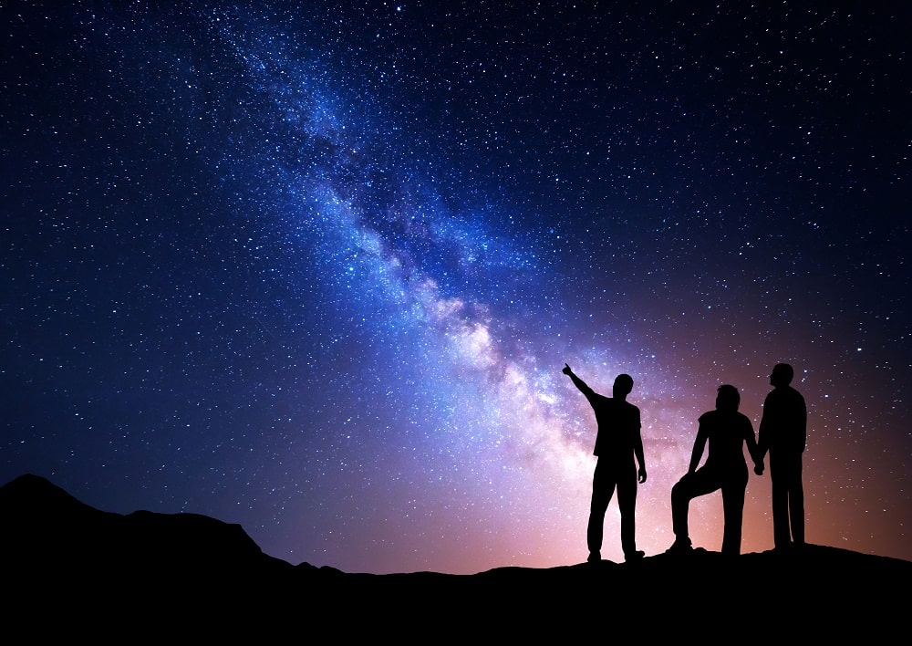 A group of students looking at the stars.